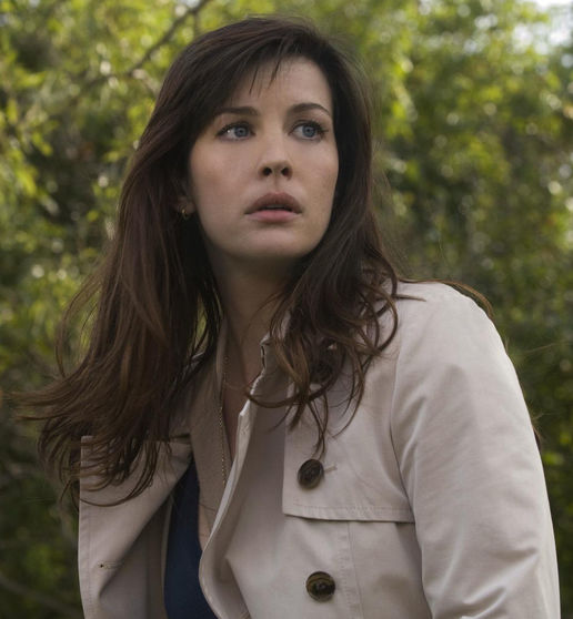 Betty Ross from the Incredible Hulk stands outside in a trenchcoat looking worried