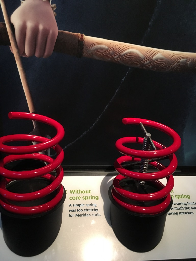 Two red springs, one with an inner structure to support the bounciness of the curls, and one without. This was used to help animate Merida's hair.