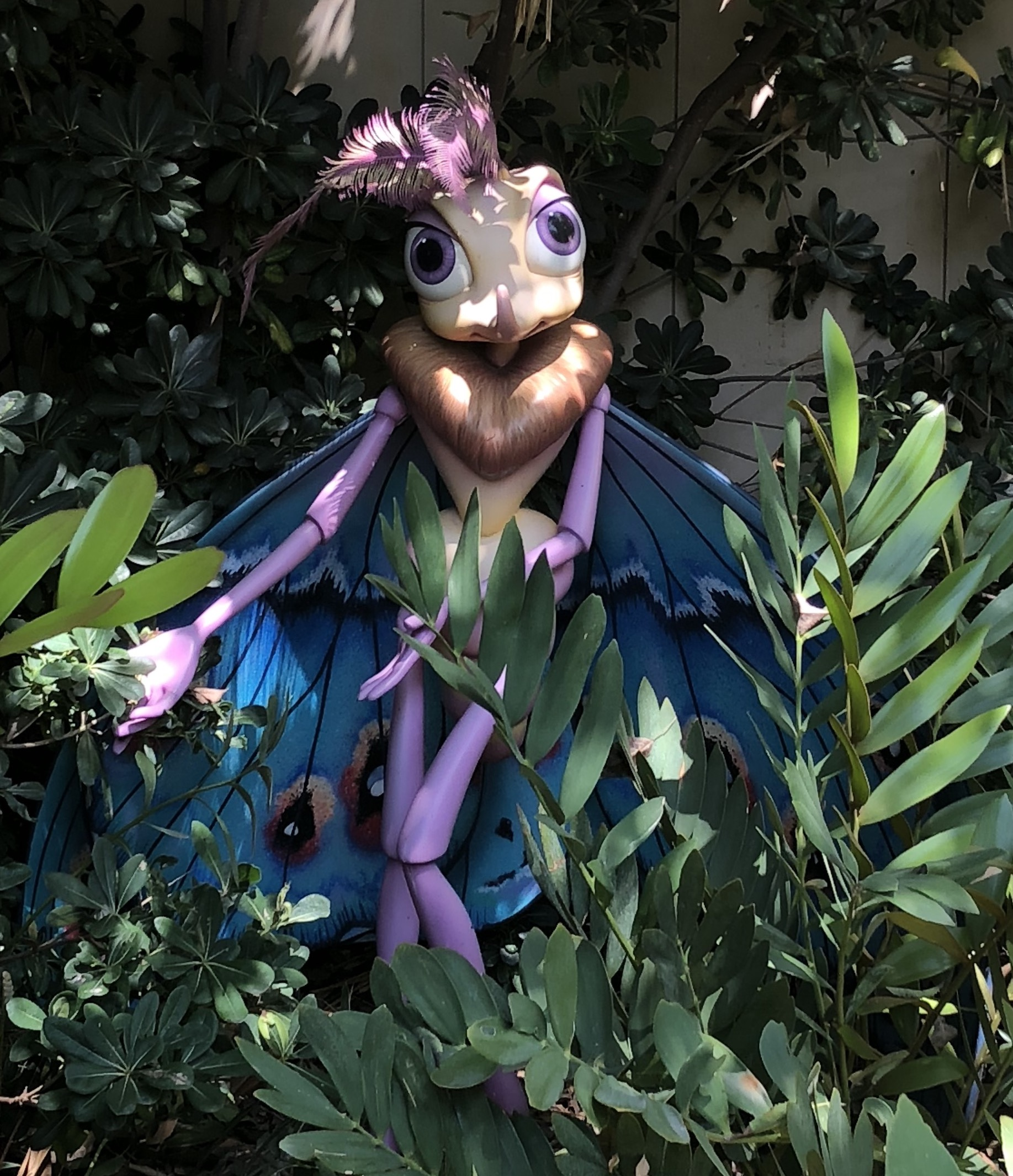 Gypsy statue in foliage at Disney's California Adventure