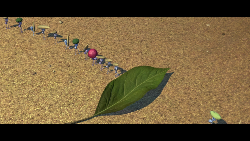 screenshot of ant foraging line stopped by leaf from Pixar's a bug's life