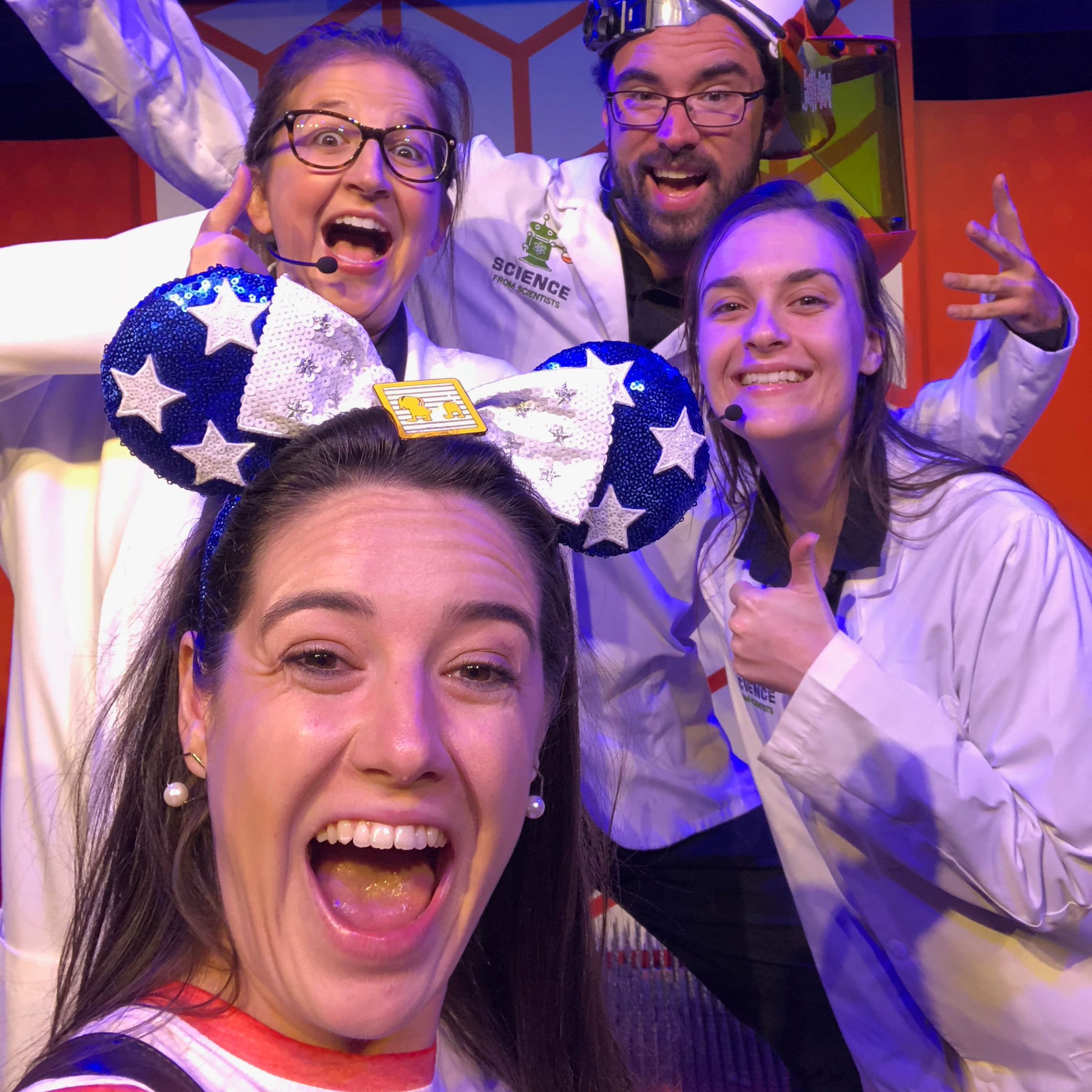 Sarah takes a selfie with three of the scientists from Epcot's Spectaculab attraction