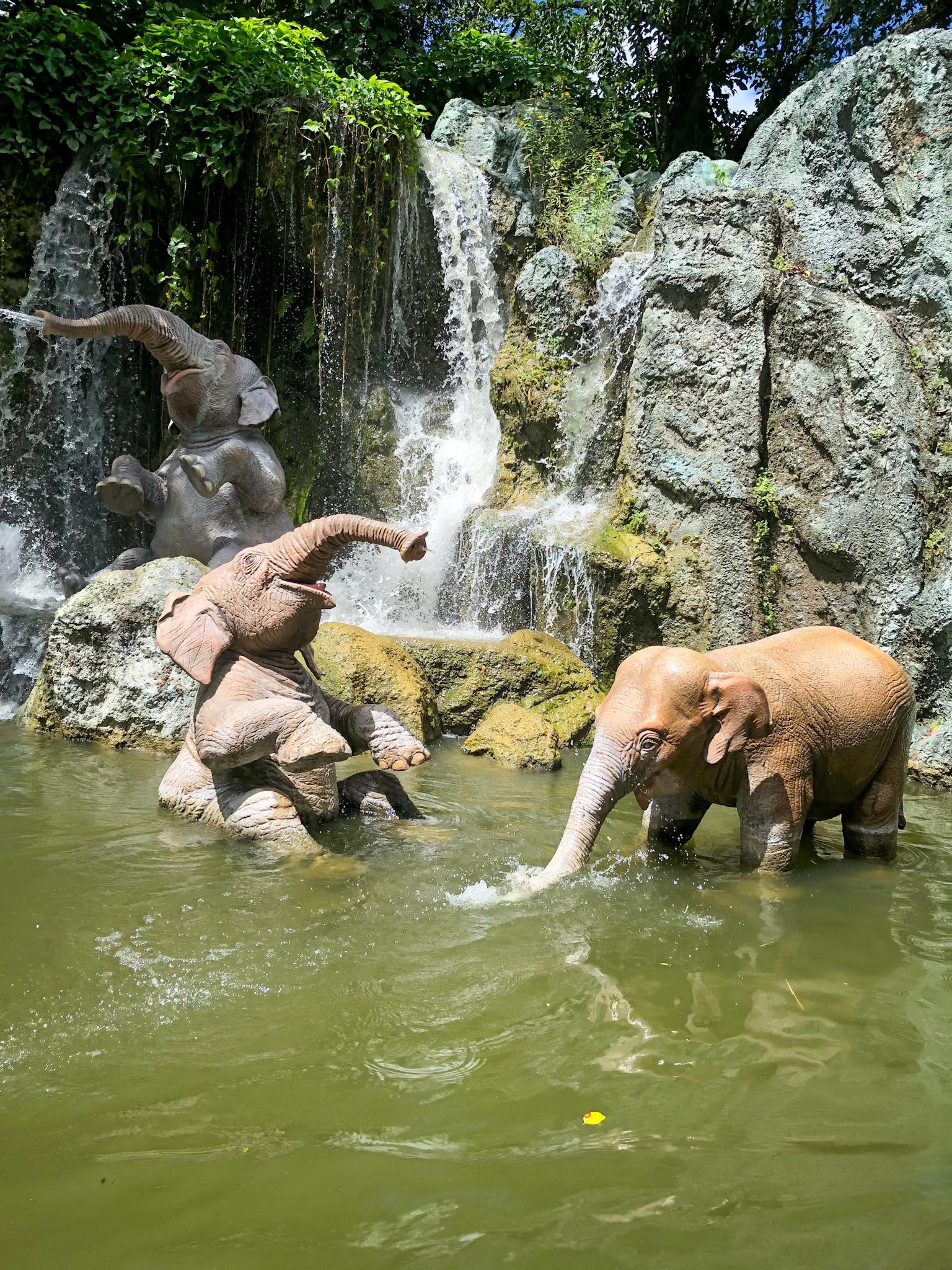Three elephant animatronics in the water