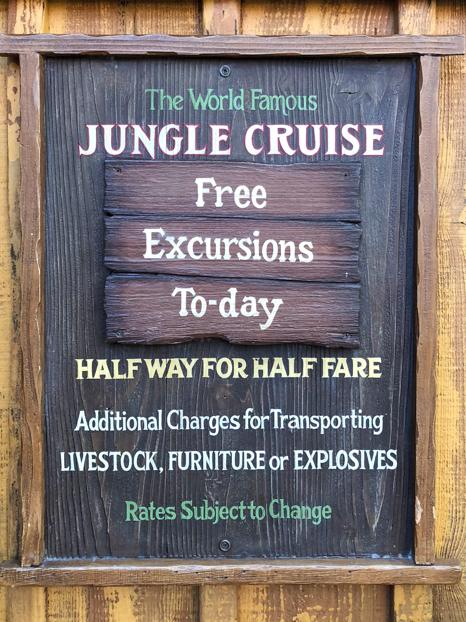 Jungle Cruise sign that offers free excursions, halfway for half fare